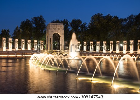 Landmark World War II Memorial fountains at the National Mall in Washington DC seen at night. - stock photo