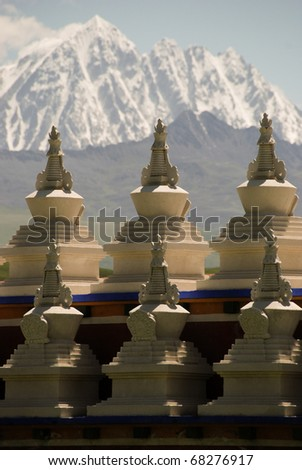 Landmarks of Tibetan stupa surrounding a rural famous lamasery - stock photo