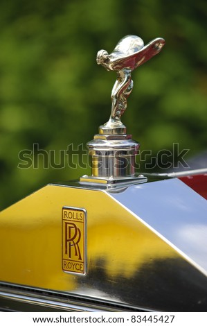 LANDSBERG, GERMANY - JULY 9: Oldtimer rallye for at least 80 years old antique cars with Emily on Rolls Royce, built at year 1930, photo taken on July 9, 2011 in Landsberg, Germany - stock photo