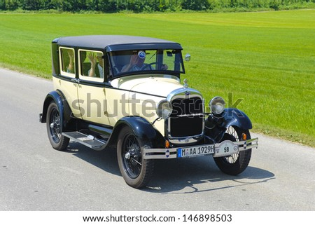 LANDSBERG, GERMANY - JULY 12: Oldtimer rallye for at least 80 years old antique cars with Ford A, built at year 1928, photo taken on July 12, 2013 in Landsberg, Germany - stock photo