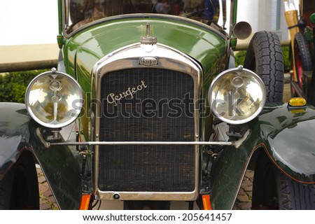 LANDSBERG, GERMANY - JULY 12, 2014: Public oldtimer rally in Bavarian city Landsberg for at least 80 years old veteran cars with a front view of Peugeot BL 177, built at year 1923 - stock photo