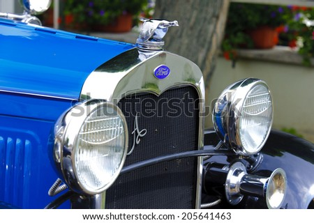 LANDSBERG, GERMANY - JULY 12, 2014: Public oldtimer rally in Bavarian city Landsberg for at least 80 years old veteran cars with a front view of Ford Tourer - stock photo