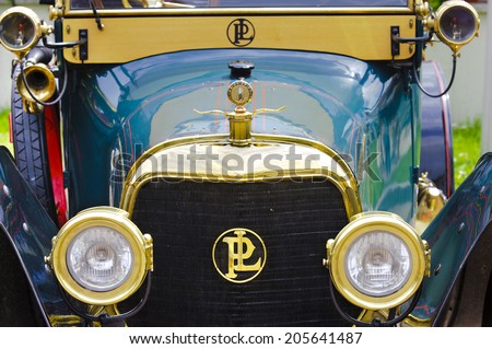 LANDSBERG, GERMANY - JULY 12, 2014: Public oldtimer rally in Bavarian city Landsberg for at least 80 years old veteran cars with a front view of Panhard X19, built at year 1913 - stock photo