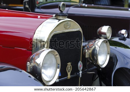 LANDSBERG, GERMANY - JULY 12, 2014: Public oldtimer rally in Bavarian city Landsberg for at least 80 years old veteran cars with a front view of Sunbeam 25 HP, built at year 1926 - stock photo