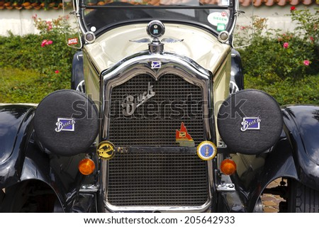 LANDSBERG, GERMANY - JULY 12, 2014: Public oldtimer rally in Bavarian city Landsberg for at least 80 years old veteran cars with a front view of Buick Master, built at year 1926 - stock photo