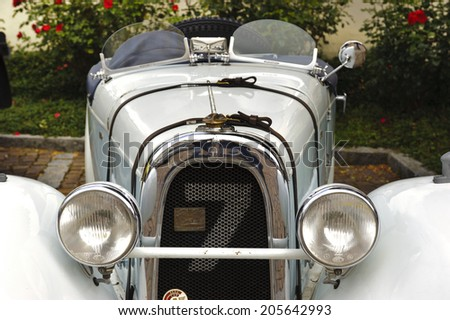 LANDSBERG, GERMANY - JULY 12, 2014: Public oldtimer rally in Bavarian city Landsberg for at least 80 years old veteran cars with a front view of Aero 10, built at year 1929 - stock photo