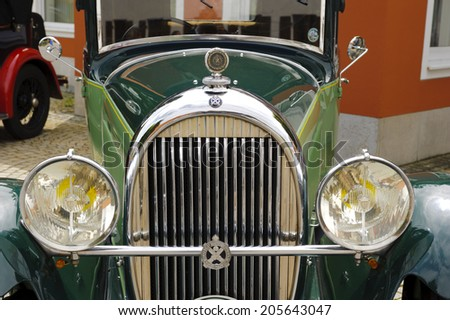 LANDSBERG, GERMANY - JULY 12, 2014: Public oldtimer rally in Bavarian city Landsberg for at least 80 years old veteran cars with a front view of Hotchkiss AM 80, built at year 1930 - stock photo