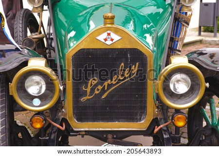 LANDSBERG, GERMANY - JULY 12, 2014: Public oldtimer rally in Bavarian city Landsberg for at least 80 years old veteran cars with a front view of Loreley LA4, built at year 1913 - stock photo