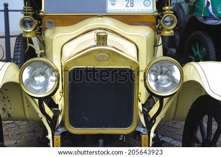 LANDSBERG, GERMANY - JULY 12, 2014: Public oldtimer rally in Bavarian city Landsberg for at least 80 years old veteran cars with a front view of Stellite, built at year 1915 - stock photo