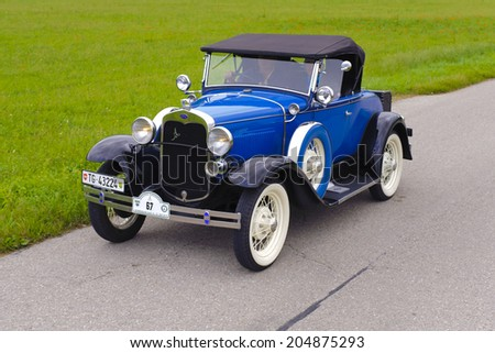 LANDSBERG, GERMANY - JULY 12, 2014: Public oldtimer rally organized by Bavarian city Landsberg for at least 80 years old cars with unknown drivers in Ford A de Luxe Roadster, built at year 1930 - stock photo