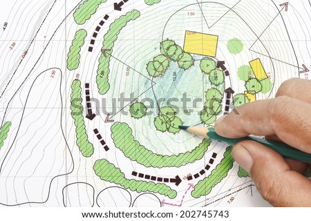 Landscape Architect Designing on site analysis plans - stock photo