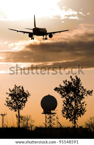 landscape at Barcelona Airport with an airplane about to land - stock photo