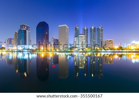 Landscape building modern business district of bangkok at twilgiht sky, beautiful water reflection.  - stock photo