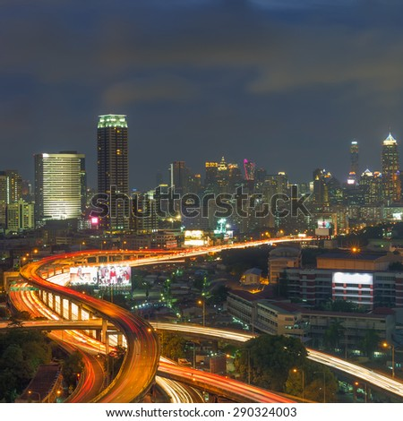 Landscape building modern business district of Bangkok. S-shaped expressway in the foreground at twilight. - stock photo