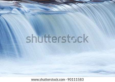 Landscape captured with blurred motion of a cascade on the Rabbit River, Michigan, USA - stock photo