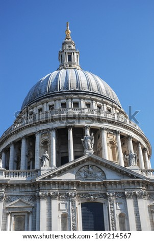 landscape front view dome of st paul cathedral in london, uk with clear sky in background - stock photo