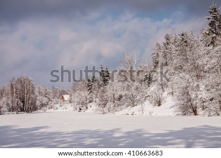 Landscape.frozen snowy river, trees. Winter nature. - stock photo