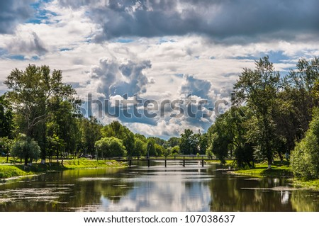 landscape green meadow stream, and the field plowed - stock photo