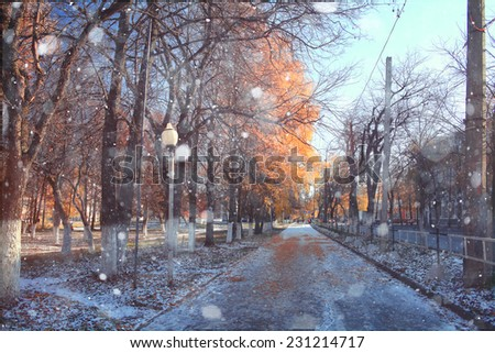 landscape in autumn park sun rays first snow - stock photo