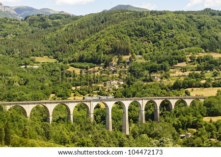 Landscape in Garfagnana (Lucca, Tuscany, Italy) at summer with train - stock photo