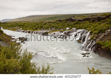 Landscape in Iceland. Big and beauty waterfall Hraunfossar. - stock photo