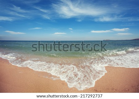 Landscape. Oceanside under blue sky with clouds - stock photo