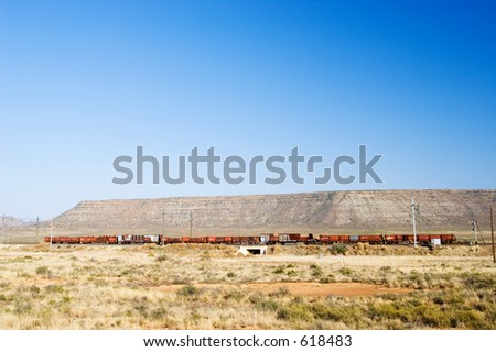 Landscape of a dry area in South Africa, with train. - stock photo