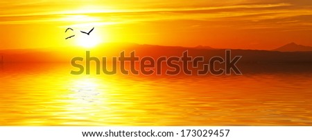 landscape of a sunrise in panoramic - stock photo
