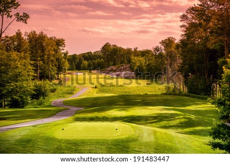 Landscape of an empty  golf course close to sunset or sunrise.  - stock photo