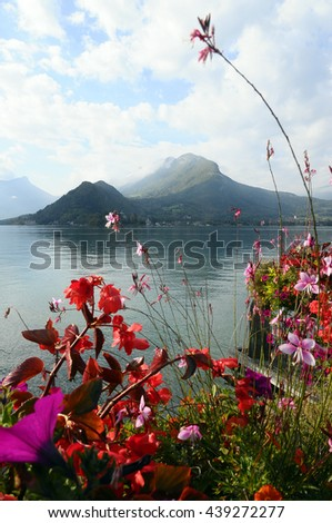 Landscape of Annecy lake and flowers in Savoy, France - stock photo