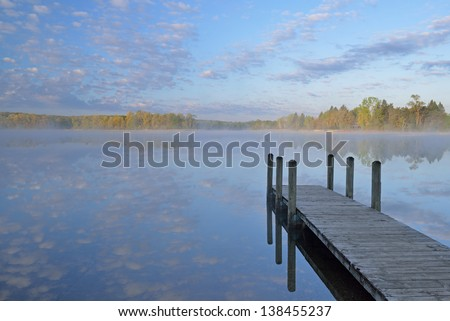 Landscape of dock and spring shoreline of Whitford Lake, Fort Custer State Park, Michigan, USA - stock photo