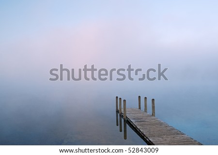 Landscape of dock in fog, Whitford Lake, Fort Custer State Park, Michigan, USA - stock photo