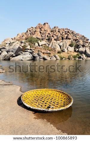Landscape of Hampi rocks and Tungabhadra River - stock photo