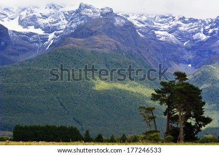 Landscape of high mountain range with snow caps near Glenorchy in the south Island, New Zealand. - stock photo