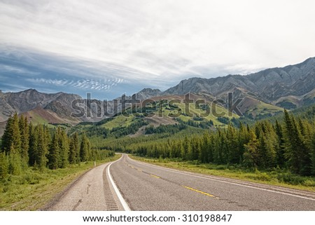 Landscape of Highway 40 through a the mountains in the Highwood Pass in Kananaskis, Alberta. - stock photo