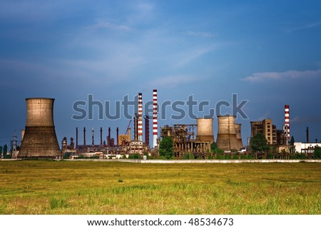Landscape of industrial site - towers at oil refinery - stock photo