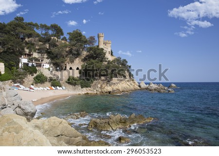 Landscape of Lloret de Mar Castle and its beach in a sunny afternoon. - stock photo