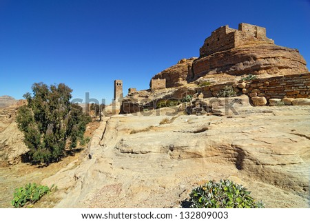 Landscape of mountain Yemen in Eastern Haraz. Old fortress against blue sky. View from Thula village - stock photo