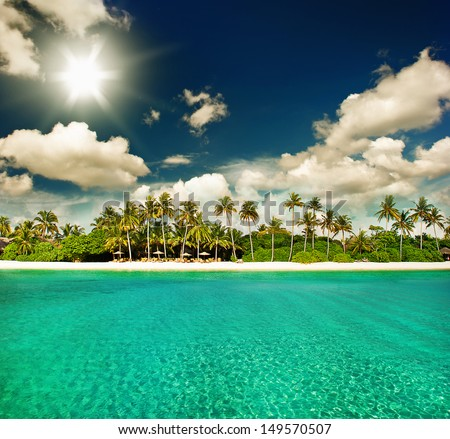landscape of paradise tropical island beach with perfect sunny sky - stock photo