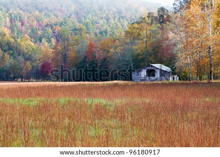 Landscape of pastoral barn in autumn - stock photo
