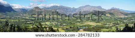 Landscape of plantation fields and mountains from Franschhoek Pass, South Africa - stock photo