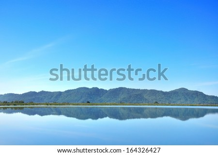 Landscape of reservoir and mountain in Nakhon Nayok, Thailand - stock photo