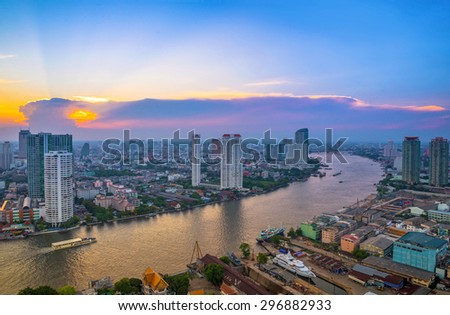 Landscape of river in Bangkok cityscape with sunset. - stock photo