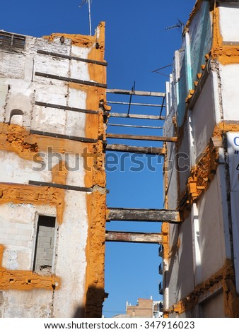 Landscape of ruined buildings at sunset, image of decrepitude or natural disaster - stock photo