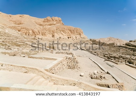 landscape of ruins of landmark Egyptian city Deir el-Medina, monument ancient village of artisans who worked in tombs of Kings Valley, in Luxor, Egypt, Africa - stock photo