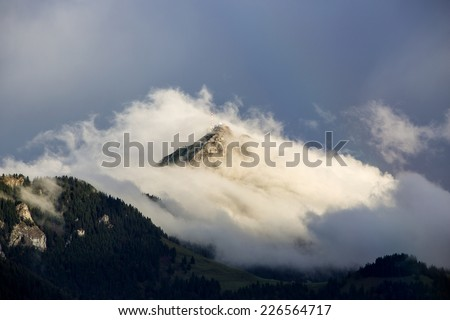Landscape of the Bavarian mountain Wendelstein with fog in autumn - stock photo
