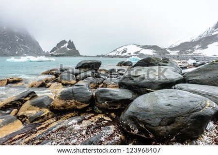 Landscape of the coast of Elephant Island, an ice-covered mountainous island off the coast of Antarctica. It is within the Antarctic claims of Argentina, Chile and the UK. - stock photo