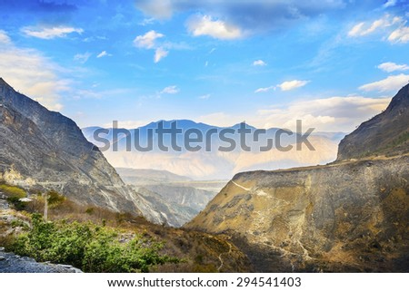 Landscape of Tiger Leaping Gorge. Lower gorge.  Located 60 kilometres north of Lijiang City, Yunnan, China. It is part of the Three Parallel Rivers of Yunnan Protected Areas World Heritage Site. - stock photo