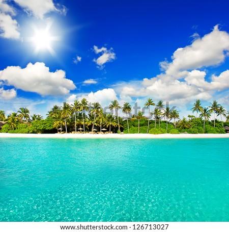 landscape of tropical island beach with cloudy sunny blue sky - stock photo