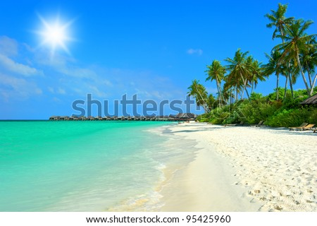 landscape of tropical island beach with perfect blue sunny sky - stock photo